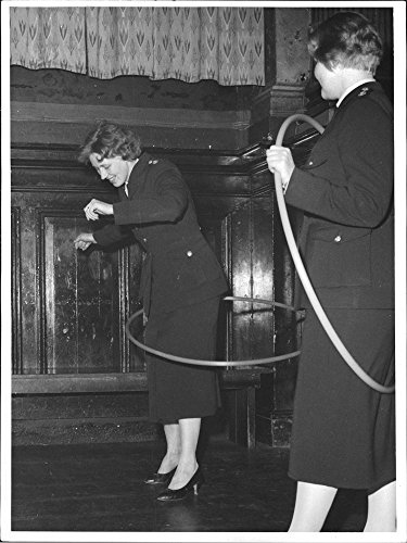vintage-photo-of-two-policewomen-try-hula-hoop-at-nalen-during-the-opening-party-for-the-new-klara-p