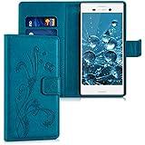 kwmobile Funda para Sony Xperia M4 Aqua - Wallet Case plegable de cuero sintético - Cover con tapa tarjetero y soporte Diseño hiedra mariposa en azul oscuro