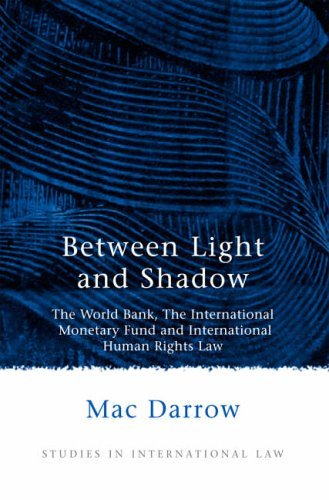 Between Light and Shadow: The World Bank, the International Monetary Fund and International Human Rights Law (Studies in International Law) by Mac Darrow (20-Jan-2006) Paperback