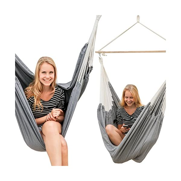 AMANKA Swing Hammock 185x130cm EXTRA-SAFE max 150Kg large cotton hanging chair XXL suspended swinging fabric seat Grey AMANKA SAFE HANGING SYSTEM - with this model there is no chance that the cloth slips out of the bar: our sturdy wooden bar is 115cm long and equipped on both ends with 3 holes in order to tie the ropes tightly and prevent any accident! COMFORTABLE - the breathable cotton fabric measures approx. 185cm in width and 130cm in length. This means that it can be used by any member of the family and not just for sitting down but also for comfortably lying down. Supported weight: max. 150kg 100% NATURAL COTTON - the fabric is resistant and durable (320g/m²), delicate even on direct contact with your skin. The huge cloth is hung on 2 S-shaped metal hooks and can be quickly washed in the washing machine at 30°C 5