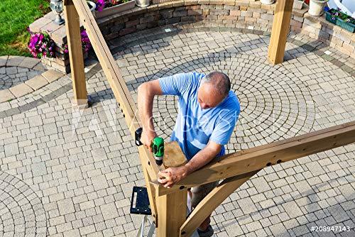 druck-shop24 Wunschmotiv: Man Building a Wooden Gazebo on a Brick Patio #208947143 - Bild hinter Acrylglas - 3:2-60 x 40 cm / 40 x 60 cm