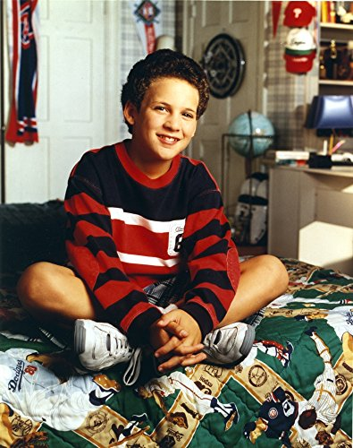The Poster Corp Ben Savage Seated on Printed Bed in Red Two Tone Long Sleeve Ringer Shirt and White Rubber Shoes Photo Print (60,96 x 76,20 cm) -