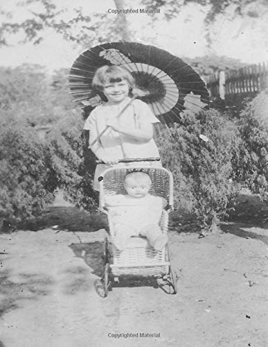 Little Girl with Wicker Doll Carriage: A photof of a little girl in the 1940's with japanese parasol pusting a doll in a wicker carriage. -
