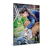 Premium Textil-Leinwand 80 cm x 120 cm  hoch, Mädchen spielt mit der Ziege und einem Hund | Wandbild, Bild auf Keilrahmen, Fertigbild auf echter Leinwand, Leinwanddruck (CALVENDO Menschen)