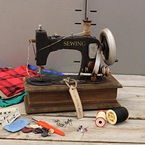 Vintage estilo antiguo adorno de modelo de máquina de coser con joyer