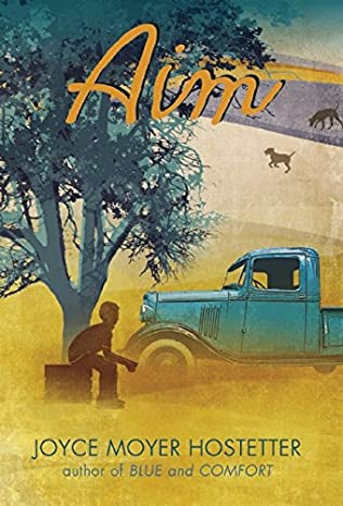 boy under tree next to truck book cover