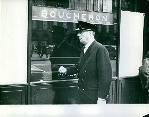 vintage-photo-of-an-officer-walking-on-the-sidewalk-beside-the-boucheron