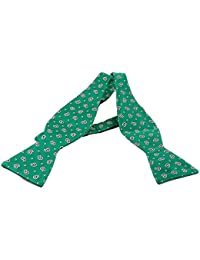 Green self tie bow tie with silver paisley design