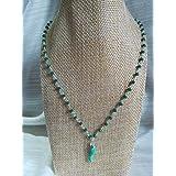 Collana girocollo stile rosario realizzata a mano di colore verde acqua e ciondolo cornetto portafortuna colore verde acqua.