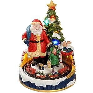 WeRChristmas - Decorazione natalizia con luci LED colorate, 20 cm, soggetto: Babbo Natale vicino all'albero con trenino