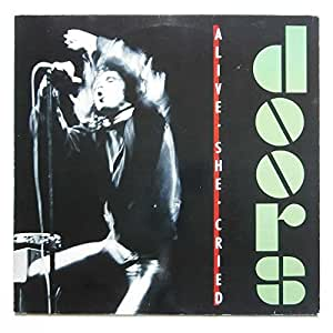 Alive she cried (1983) / Vinyl record [Vinyl-LP]