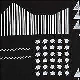 Schwarzes Wachstuch mit Formen von echino