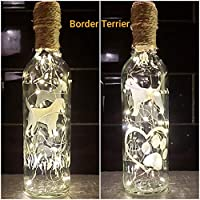 BORDER TERRIER DOG. CLEAR. HAND ETCHED WINE BOTTLE, TRIMMED WITH TWINE AND CHARMS. LIGHTS