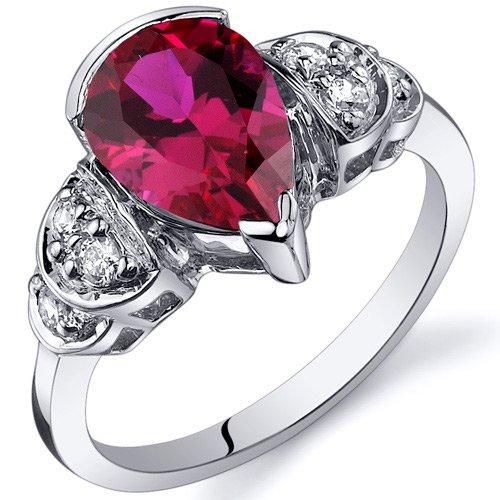Revoni - Anillo de compromiso de plata de ley con rubí sintético