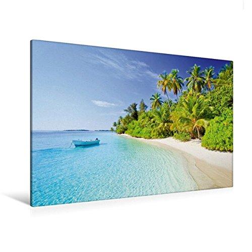 Premium Textil-Leinwand 120 cm x 80 cm quer, Kleines Boot schaukelt vor einem tropischen Strand mit Kokospalmen | Wandbild, Bild auf Keilrahmen. Malediven, Indischer Ozean (CALVENDO Orte)