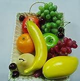 Simulation von Obst, Gemüse, Weintrauben, Rosinen und Ananas Obst legen