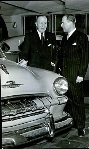 vintage-photo-of-cn-galer-and-cj-kjellberg-standing-beside-the-1953-plymouth-on-display-at-nykoping-