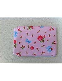 Flores de color rosa y arcos tarjetero