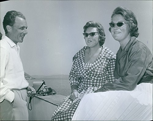 vintage-photo-of-a-man-looking-and-smiling-at-princess-beatrix-and-princess-irene-of-the-netherlands