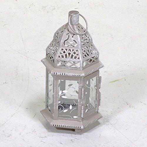 Porta velas tipo farol metálico con cubiertas de cristal color gris forma hexagonal