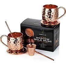 Juego de dos tazas de cobre para Moscow Mule Hechas a mano por Riches & Lee – Este set regalo 100% de cobre incluye: 2 tazas, 2 Posavasos, 2 Pajitas, 1 vasito medidor además de un ebook de recetas de cócteles