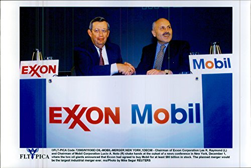 vintage-photo-of-exxonmobil-chairman-of-exxon-corporation-lee-r-raymond-together-with-the-chair-mobi