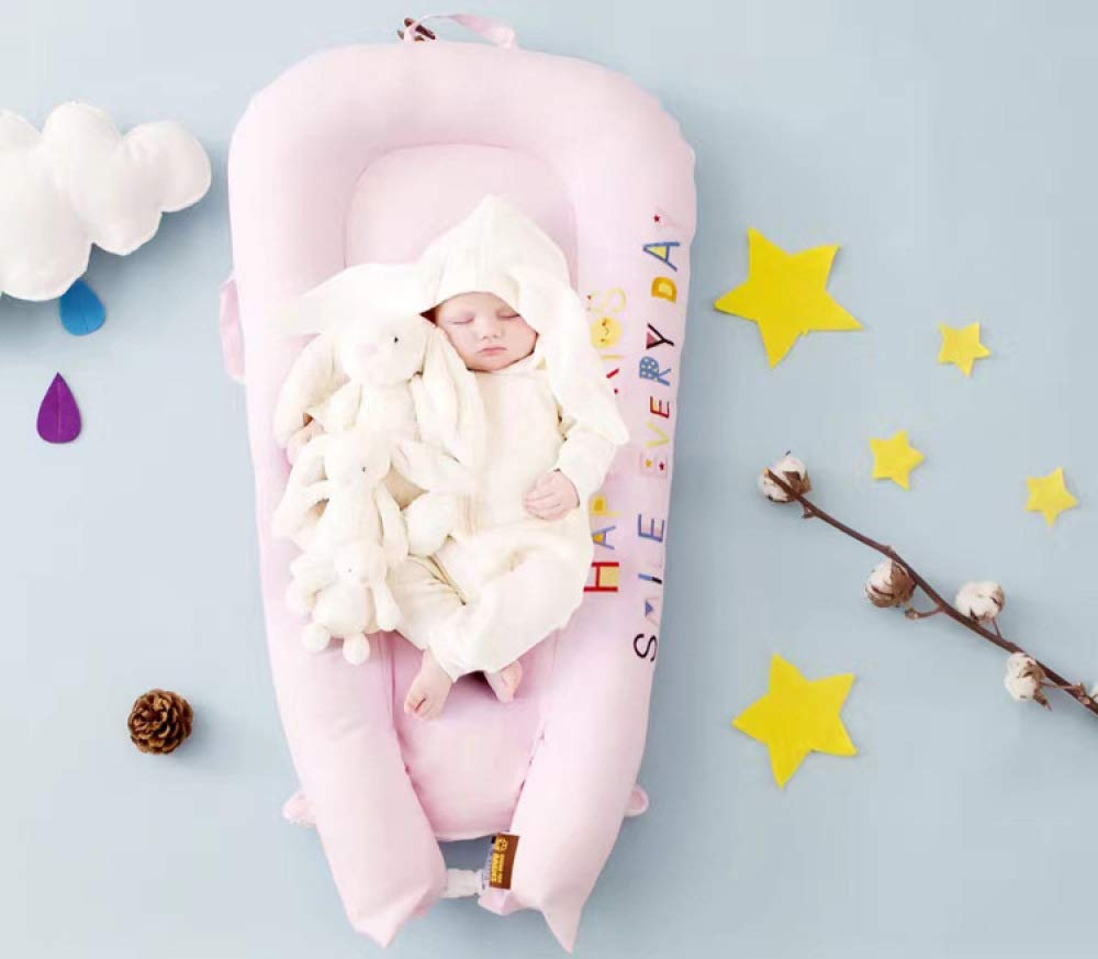 YANGGUANGBAOBEI Baby Lounger Cushion,for Newborn - Babies - Soft Sleeping Cribs Cuddle Pads,100% Cotton Portable Crib,Pink(small) YANGGUANGBAOBEI [Portable]: The lightweight design makes the baby lounger easy as a bassinet for a bed, or travel bed. Makes baby feel more secure and cozy. [Breathable Material]: Made of 100% cotton fabric and high quality 3D polymer material filler. Safe to baby's sensitive skin. It can give your baby safe and just like sleeping in the mother's arms, enjoying more deep sleep. [Creative Design]: The baby lounger simulates the bionic design of the uterus, like sleeping in the mother's arms, enjoying more deep sleep, and reducing the frequency of putting kids go to bed. 1