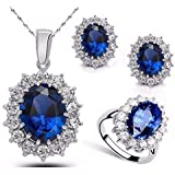 A set consisting of a necklace, a 7 ring and earrings with a blue zircon stone