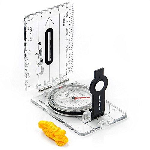 Ein Kompass mit einem Lineal GEFALTET MIT EINER LUPE