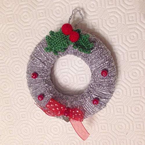 Ghirlanda natalizia in argento con agrifoglio fatto a mano all'uncinetto