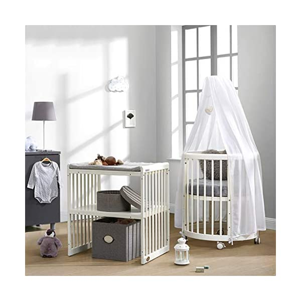 DUWEN Wooden Baby Cot Convertible To 3 Positions Toddler Bed European Multifunctional Small Round Bed Child Bed Sofa Bed Suitable For Cribs Under 6 Years (Color : White, Size : 123cm*68cm*76cm) DUWEN 【CONVERTIBLE CRIB】:Easy-to-change 3-in-1 cot can be easily converted from a crib to a nursing table and crib. The versatile crib will provide your child with a comfortable sleep. Beautifully designed cribs can grow with your child from infancy through childhood to adulthood. 【GROW UP WITH YOUR BABY】: The 3-bed mattress height adjustment function on the crib allows you to lower the mattress when your baby starts sitting or standing. It can keep your baby safe and comfortable in the bed that grows up with your baby. This convertible adjustable multifunctional bed will make your child's life unforgettable. 【STURDY PINE WOOD】: A crib is the perfect solution for a peaceful and worry-free sleep for parents and children. The crib is made of high-quality beech wood, which is durable and easy to deform without harming the baby. With a carrying capacity of more than 80KG, it is easy to assemble and is designed for the healthy sleep of babies aged 0-6. 4