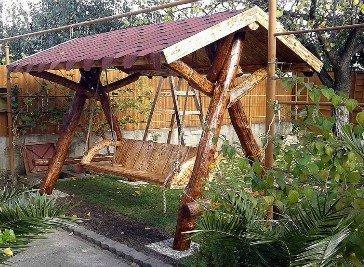 Casa Padrino Garten Schaukel Rustikal überdacht Hollywood Schaukel Mod S1 - Eiche Massivholz - Echtholz Massiv -