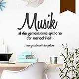 """WANDKINGS Wandtattoo """"Musik ist die gemeinsame Sprache der Menschheit. (Henry Wadsworth Longfellow)"""" 70 x 56 cm - Braun - Wähle aus 5 Größen & 35 Farben"""