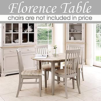 Florence round extending table (92-117cm). Stunning 100% hardwood round kitchen table in truffle colour and hard wearing limed wooden top.