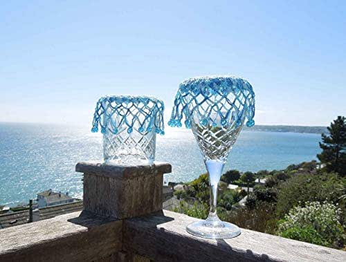 Pair crochet glass covers, jug toppers, with blue glass beads.