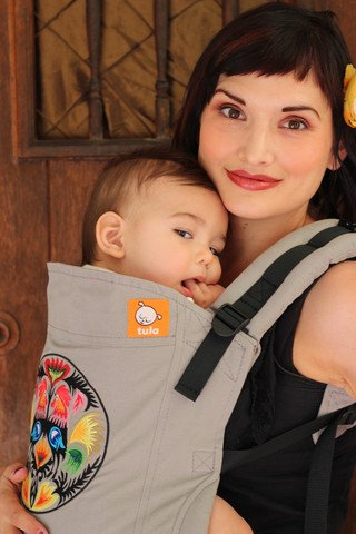 Tula Ergonomic Toddler Carrier, Folk Art Tula ERGONOMIC M-POSITION SEAT: supports safe development for baby's body MULTIPLE ERGONOMIC POSITIONS: front and back carry options to provide a natural, ergonomic position best for long term, comfortable carrying that promotes healthy hip and spine development for baby EASY-TO-ADJUST DESIGN: allows for long-time carrier use from infancy to toddlerhood, can be used from 15 - 45 pounds or 7 - 45 pounds with use of infant insert 1