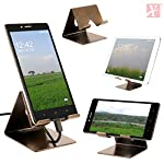 100% Brand New and High Quality! Stylish Innovative Design with Compact Size. It is compatible with most smartphones & tablets. Anti-slip grips provided at the bottom for better stability. Perfect for desk or table to watch videos, read, browse e...