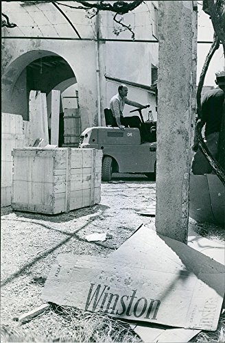 vintage-photo-of-a-man-in-the-warehouse-driving-loading-vehicle