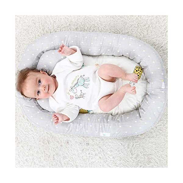 Moonvvin Portable Baby Lounger Breathable Hypoallergenic Co-Sleeping Baby Cot Bed Portable Crib for Bedroom/Travel  We use 100-percent cotton fabric and breathable, hypoallergenic internal filler, which is safe for baby's sensitive skin. It will give your child serene, safe, and sound sleep in their lovely co sleeping crib. Your child will feel comfortable and safe in our soft newborn lounger. Such a secure sleeper will allow your baby to have deep and nice sleep as little ones love the imitation of a stay in the mother's womb. It helps with common newborn sleep issues like wanting to sleep in a parent's arms or frequent waking. Use the infant lounger as a bassinet for a bed, side sleeper, travel bed, newborn pillow, changing station or move it around the house for lounging or tummy time, making baby feel more secure and cozy. The lightweight design and easy-to-use package with handle make our in bed bassinet a portable baby must-have. 9