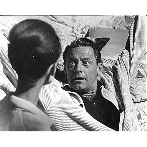 William Holden looking at intense attitude of