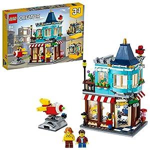 LEGO Creator3in1 NegoziodiGiocattoli -Pasticceria-Fioraio,con Razzo-Giostra Funzionante, Set di Costruzioni, 31105 5702016616316 LEGO