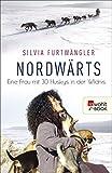 Image de Nordwärts: Eine Frau mit 30 Huskys in der Wildnis