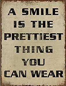 Inspiration Poster Plaque En Métal - A Smile Is The Prettiest Thing You Can Wear (35 x 26 cm)