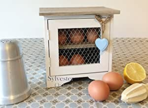 White Egg Cabinet with Blue Hanging Heart.