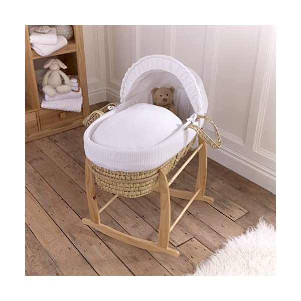 Waffle Palm Moses Basket - White  Breathable Waffle cotton dressings are super soft next to your baby's skin. Comes complete with two carry handles, adjustable hood, 2.0 tog coverlet & mattress. Quality hand-woven palm Moses basket, a lightweight & sturdy design 2