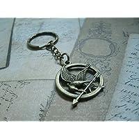 """Porte-clés ' Geai Moqueur"""" en metal couleur bronze argent ou or"""