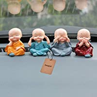Set of 4 little monk idols which is made from resin and is available in a set of attractive colours. It is suitable for your car interiors, home decor and can be placed on your bookshelf, closet, dresser, computer table etc.