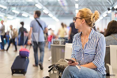 Wunschmotiv: Casual blond young woman using her cell phone while waiting to board a plane at departure gates at international airport. #202148252 - Bild als Klebe-Folie - 3:2 - 60 x 40 cm / 40 x 60 cm Cell Board