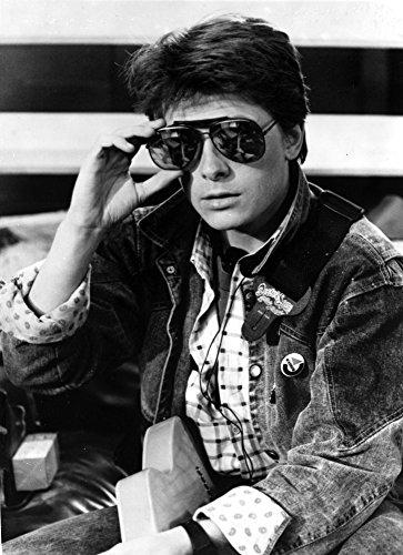 The Poster Corp Michael J Fox Wearing Aviator Sunglasses and a Denim Jacket Photo Print (20,32 x 25,40 cm)
