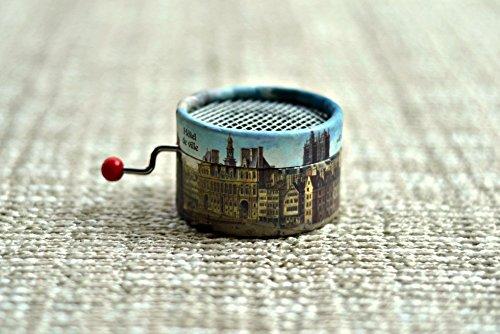 caja-de-musica-manual-redonda-con-edificios-de-paris-con-melodias-de-musica-clasica